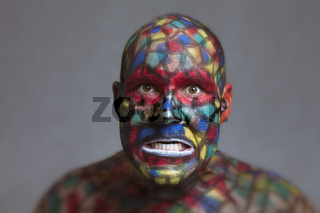 Furious villain colorful face looking at you
