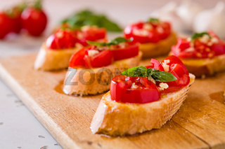 Closeup of Italian bruschetta with tomato, basil and garlic