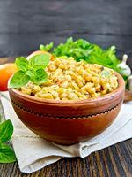 Barley porridge with basil on napkin