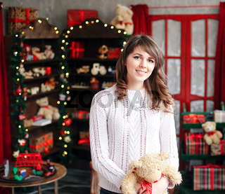 Portrait of pretty girl on background Christmas tree.