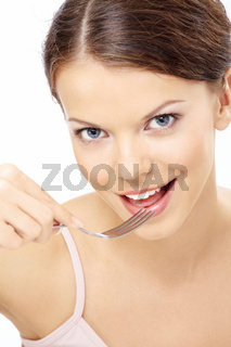 Portrait of girl eating something from a spoon