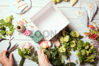 Box with flowers and macaroons