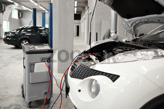 Mechanic work in automobile shop, repair climate on car