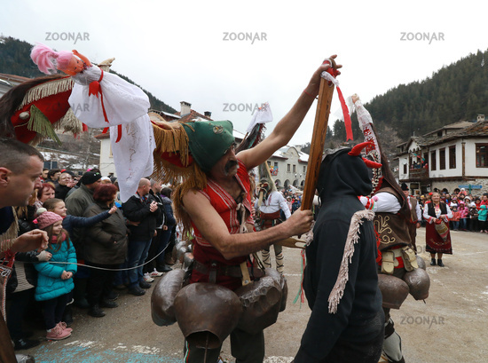 Shiroka laka, Bulgaria - March 4, 2018: People in in traditional Kukeri costume are seen at the Festival of the Masquerade Games