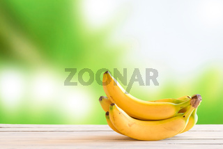 Yellow bananas on a wooden table