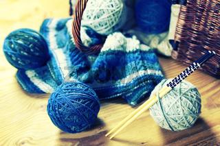 wool balls and knitting needles