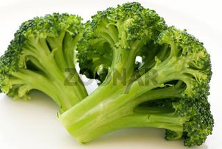 Broccoli floret as closeup on white background,