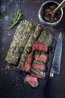 Barbecue Saddle of Venison on old Metal Sheet