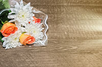 Flowers lie on wooden background