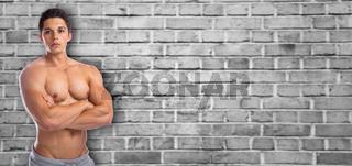 Bodybuilder Bodybuilding Muskeln Mann stark muskulös Textfreiraum Copyspace jung Oberkörper