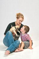 Kissing the new family pet Pug