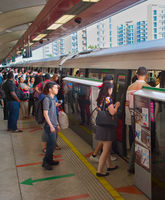 People boarding subway train. Singapore