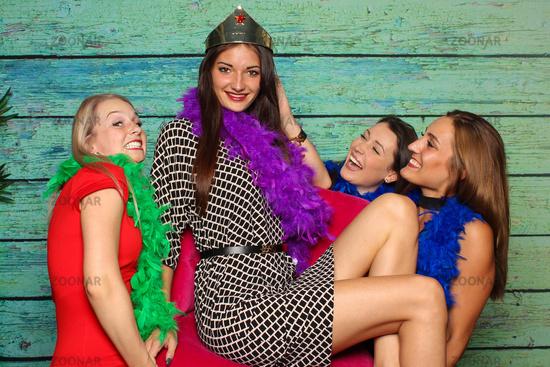 girlfriends wear their queen in a chair - fotobox party