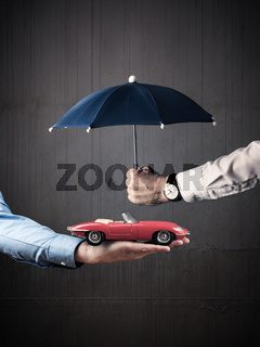 Businessman with a protective umbrella