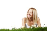Woman on grass with flowers