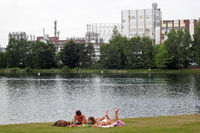 swimming area Badenweiher with the chemical park in the background, Marl, Ruhr area, Germany