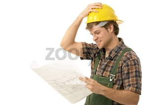 Young builder looking at floor plan