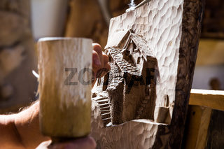 Sculptor hands working wood