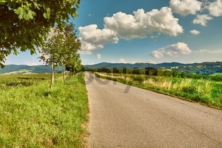 Countryside road in hilly landscpe