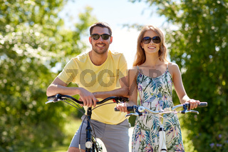 happy couple with bicycles at country