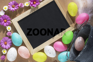 Easter eggs and a chalkboard with flowers