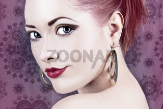 Beautiful woman with blue eyes and red lips on purple background . Red hair