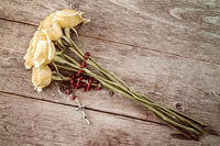 Rosary and yellow roses