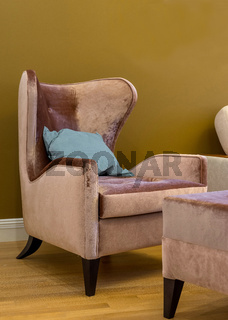 wing chair with blue cushion