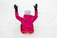 Girl sledding on the hill