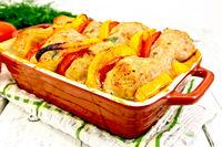 Cutlets of turkey in roasting pan on napkin