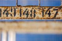 Rusted number on the hangers of the changing room