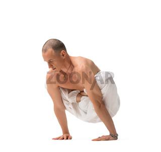 Mature shirtless handsome man doing yoga