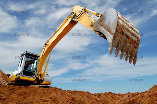 Excavator loader in sandpit