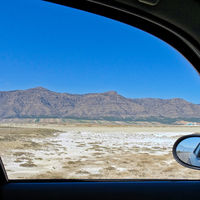 View from the window of a car to the semi-desert in Central Turkey with a salty depression in the fo