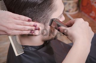 Handsome man in hairdressing saloon