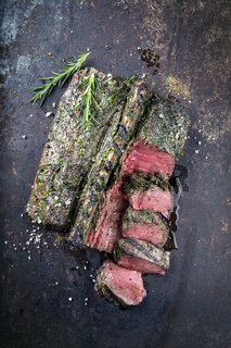 Saddle of Venison on old Metal Sheet