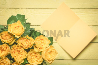 Roses bouquet and a blank message card