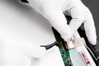 repairman detaches the contacts of laptop screen
