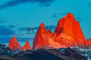 Fitz Roy illuminates the crimson sunset