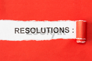 The phrase RESOLUTIONS behind torn paper