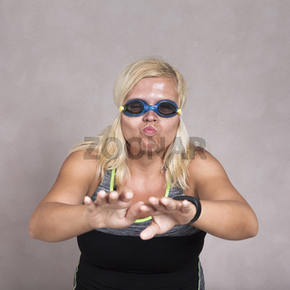 Woman in swimming goggles learning to swim