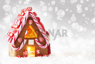 Gingerbread House, Silver Background With Bokeh And Snowflakes, Copy Space