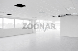 Empty bright interior white office under construction without furniture inside