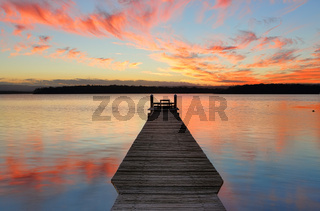 Sunset over St Georges Basin with timber jetty