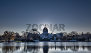 Sunrise behind the dome of the Capitol in DC