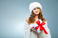 Young attractive girl in Christmas style over grey