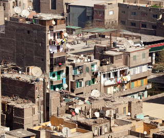 Unfinished buildings in downtown Cairo with trash on all roofs