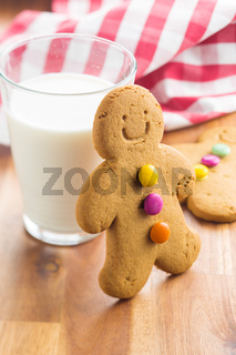 Sweet gingerbread man and glass of milk.