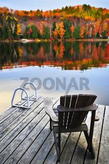 Wooden dock on autumn lake