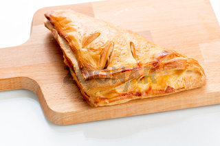 Puff pastry pies with with honey, berries and nuts .